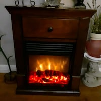 Electric Fire Place In A Cherry Cabnet