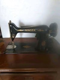 antique Singer sewing machine open to trades