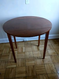 round brown wooden table with black metal base Washington, 20016