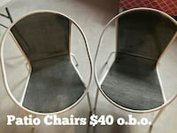 two beige metal patio chairs