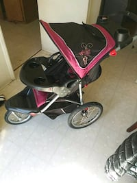 baby's black and red jogging stroller Baltimore, 21207