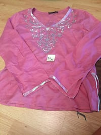 pink and white long-sleeved shirt Quebec City, G1S 1S5