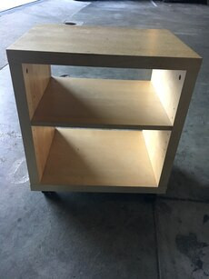 Brown wooden shelf with wheels