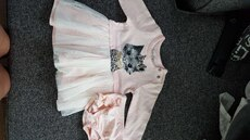 girl's white tutu dress with pink diaper cover
