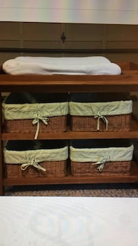 Light Oak wooden changing table with four basket containers
