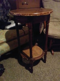 Antique round brown wooden side table