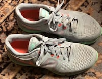 Pair of gray nike running shoes size 8.5 179 mi