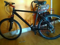 black and red hardtail bike 140 mi