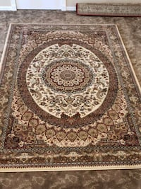 Cream, brown and burgundy color, 7'by10' area rug