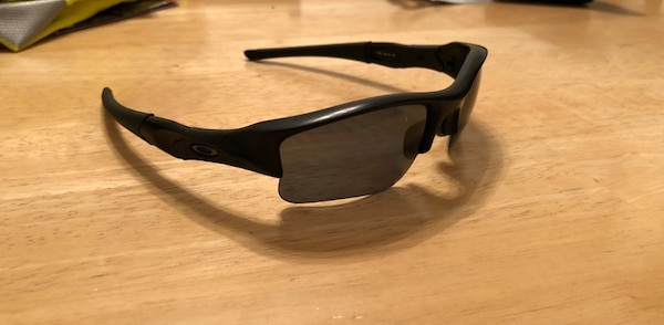 Black framed oakley sports sunglasses