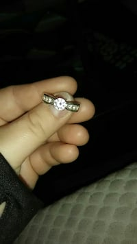 silver-colored and diamond encrusted ring