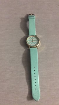 round silver-colored analog watch with teal strap 549 km