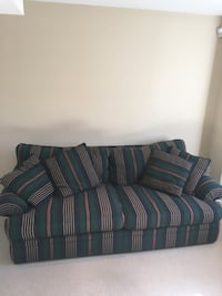 blue and gray striped fabric sofa