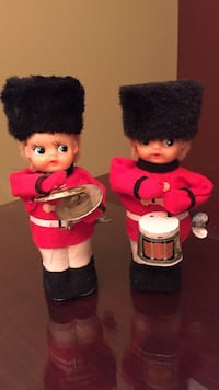 Nutcracker guard dolls that play instruments.Over 70 year old tin toys