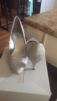 Pair of silver glittered platform stilettos London