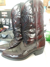 brown-and-black patent leather heeled cowboy boots