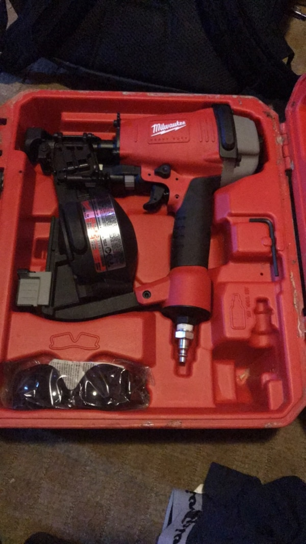 Red and black milwaukee Coil Roofing Nailer