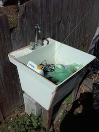 white commercial sink with stainless steel faucet Florence Township