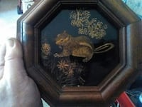 Small octagon black and gold engraved squirrel pic Kimberling City, 65686