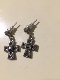two silver-colored and black cross pendant necklaces 154 mi