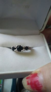 silver-colored ring with onyx gemstones