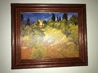 brown wooden framed painting of house Montreal