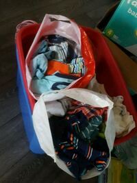 assorted clothes in red plastic bag Saint-Hyacinthe, J2R 1Y7