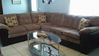 brown suede sectional couch with ottoman
