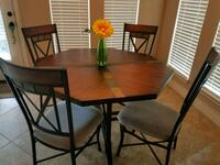 rectangular brown wooden table with four chairs dining set Houston, 77082