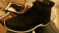unpaired black and white Air Jordan basketball shoe