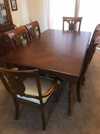 Rectangular brown wooden table with six chairs dining set. Also has large china closet and hutch. Cherry wood. Minor scraps. $2,000 OBO. Willing to deliver if in reasonable distance.  41 km