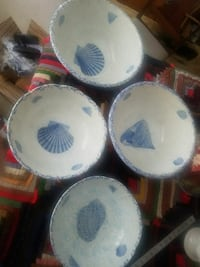 four white-and-blue ceramic plates 692 mi
