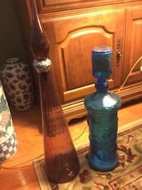Two blue and brown glass bottles.