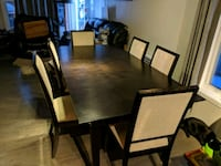 rectangular brown wooden table with six chairs di