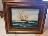 brown wooden framed ship painting