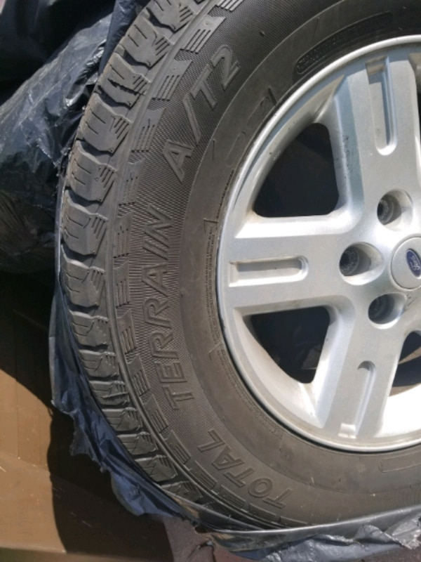 235 70 R16 ALLOY TIRES FOR SALE FITS FORD AND OTHER VEHICLE a037d3d0-5bab-48aa-a6b6-c1210d78da07