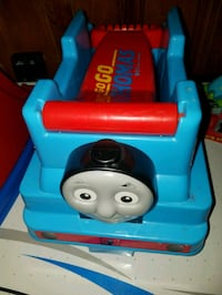 blue and red Thomas the Train ride-on toy 250 mi