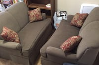 Pair of Sage Green matching gliding love seats with 2 pillows each Johnston, 50131