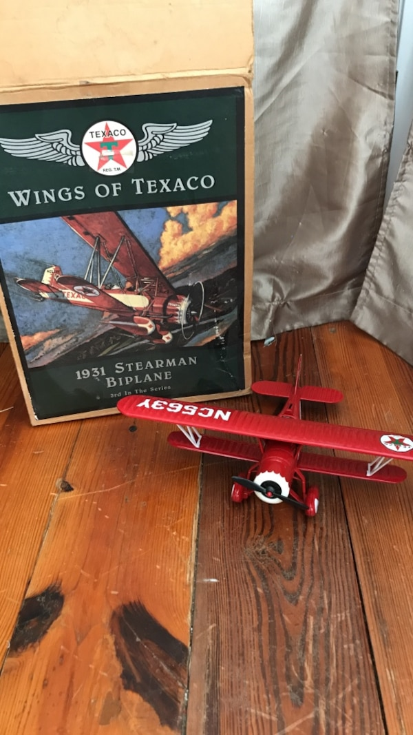Red and white Texaco 1931 Stearman biplane with box