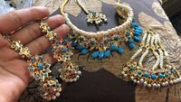 blue and gold beaded necklace and earrings New York, 11427