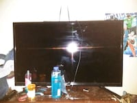 black flat screen TV with remote Hermantown, 55811