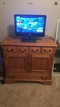 brown wooden TV stand with flat screen television Baton Rouge, 70808