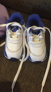toddler's pair of blue-and-white Nike sneakers Broken Arrow, 74011