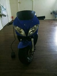 blue and black motor scooter 2409 mi