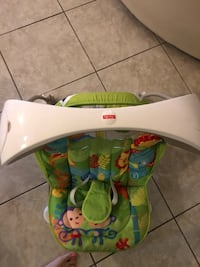 baby's green and white Fisher Price bouncer Oakley, 94561