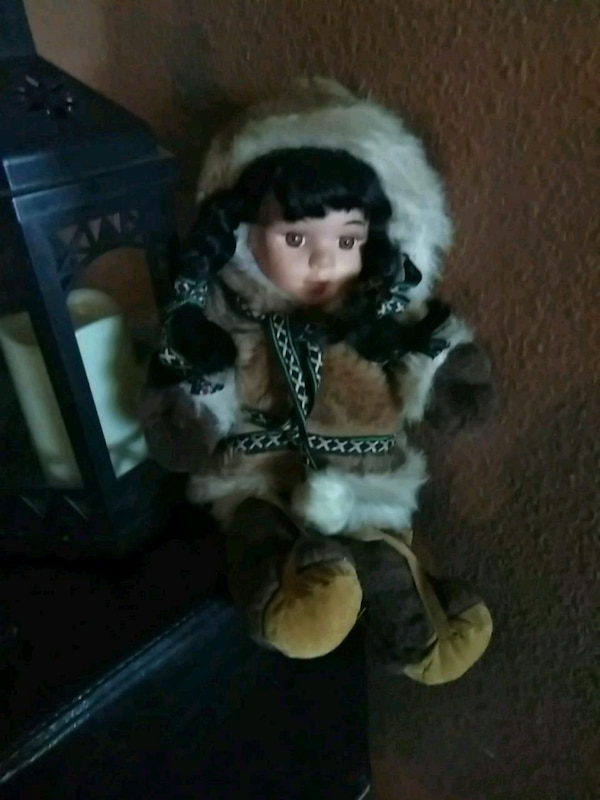 doll with brown and white fur coat
