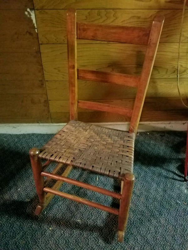 brown wooden rocking chair with brown cushion