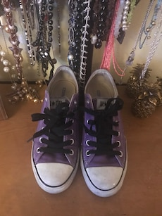 pair of purple converse all star low tops