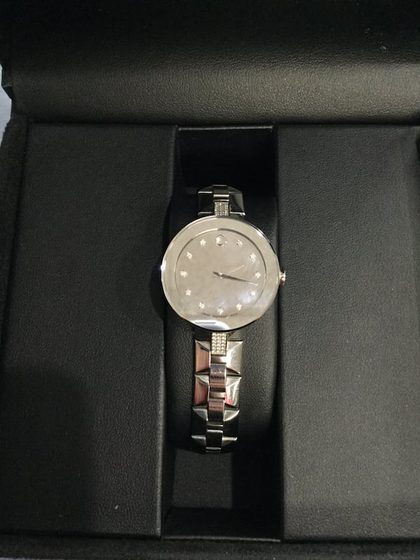 Ladies Movado Sapphire silver mirror watch with diamonds fd6dcc8b-b318-4d84-af10-88222afb27c2