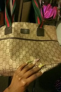 monogrammed brown Gucci leather tote bag Baltimore, 21224